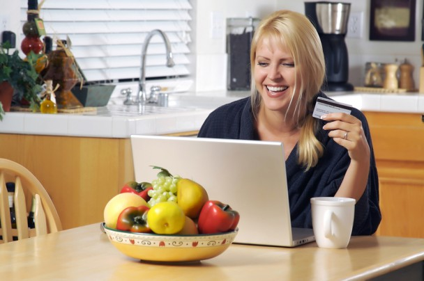 Woman Using Laptop for E-commerce