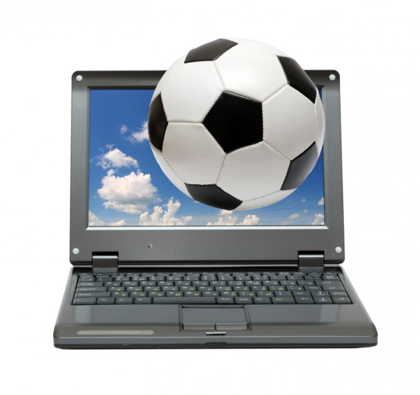 small laptop with soccer football ball