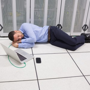 Man sleeping in data center on the floor