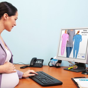 Pregnant businesswoman online shopping
