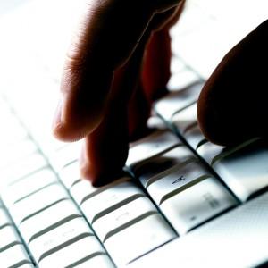 stockfresh_1747151_hand-on-laptop_sizeS