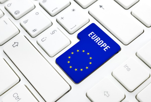 Europe web concept. blue and star flag enter button or key on white keyboard
