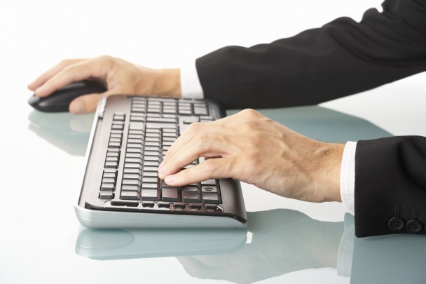 male manager using wireless keyboard and mouse