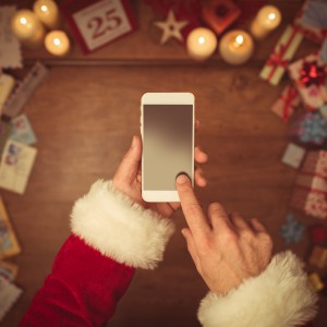 Santa Claus using a smart phone