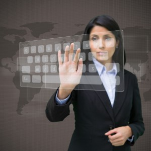 Businesswoman touching projected digital keyboard on brown world map
