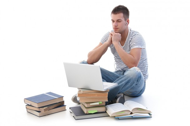 Young student using laptop studying