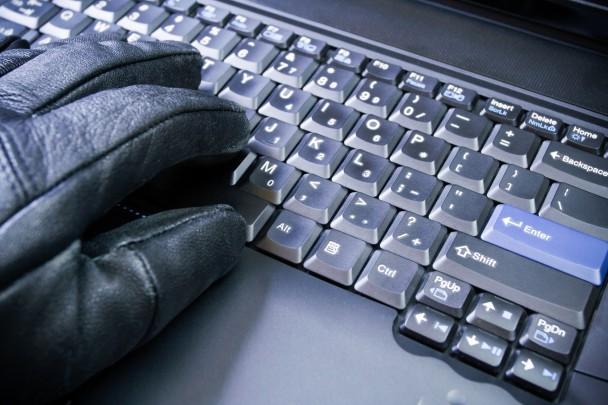 Computer hacker working on laptop