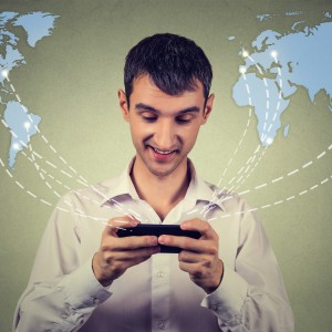business man holding smartphone connected browsing internet worldwide