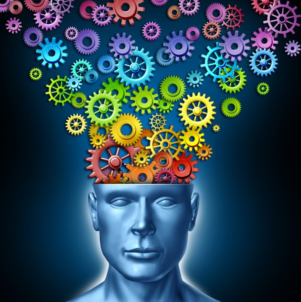 Human imagination and creative man as the intelligent brain with a front facing human head that has rainbow spectrum colored gears and cogs expressing itself out of the persons mind as a symbol of artistic design innovation and new thinking in business leadership.