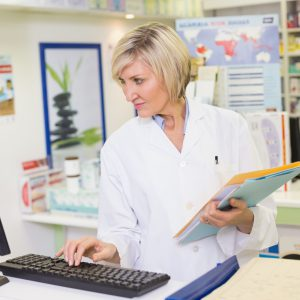 Pharmacist using the computer at the pharmacy